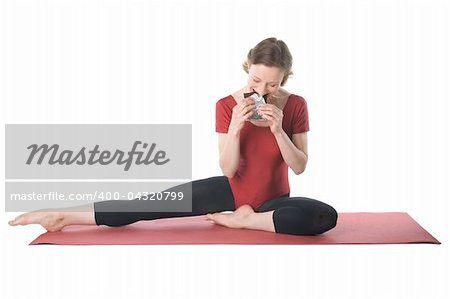 Young woman in sports clothes eating chocolate Stock Photo - Budget Royalty-Free, Image code: 400-04320799