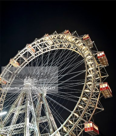 Wiener Riesenrad in Prater - oldest and biggest ferris wheel in Austria. Symbol of Vienna city at night Stock Photo - Budget Royalty-Free, Image code: 400-04326477