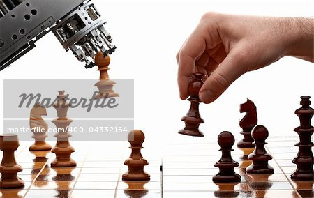 human playing chess with a machine Stock Photo - Budget Royalty-Free, Image code: 400-04332154