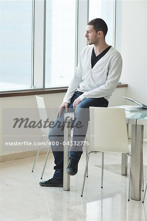 happy young man in fashion clothing posing Stock Photo - Budget Royalty-Free, Image code: 400-04332775