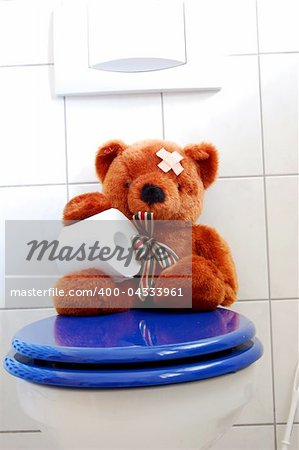 toy teddy bear with paper in the bathroom on toilet Stock Photo - Budget Royalty-Free, Image code: 400-04333961