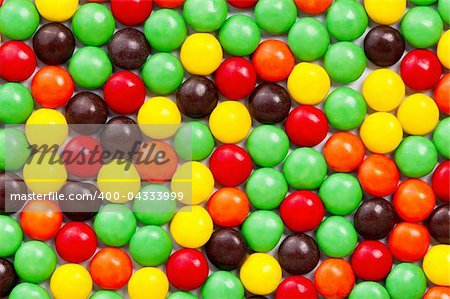 Background of colorful candies coated chocolate sweets Stock Photo - Budget Royalty-Free, Image code: 400-04333999