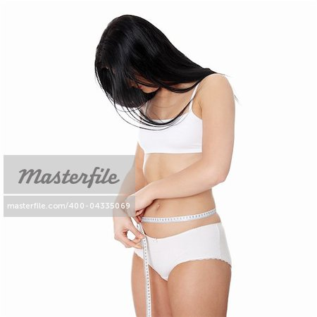 Sexy, young woman measuring her waist, isolated on white Stock Photo - Budget Royalty-Free, Image code: 400-04335069