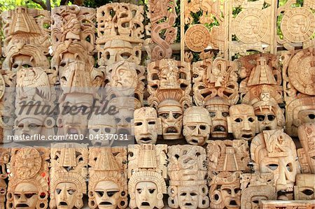 Mayan wood mask rows Mexico handcraft faces indian culture Stock Photo - Budget Royalty-Free, Image code: 400-04337031