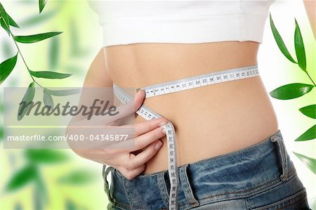 Sexy, fit, young woman measuring her waist Stock Photo - Budget Royalty-Free, Image code: 400-04345877