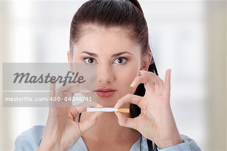 Young woman breaking cigarette Stock Photo - Budget Royalty-Free, Image code: 400-04346741