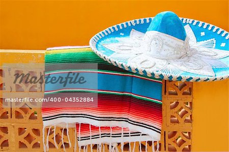charro mariachi blue mexican hat serape poncho over orange tiles wall Stock Photo - Budget Royalty-Free, Image code: 400-04352884