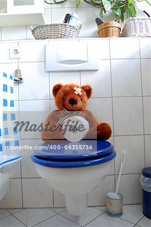 toy teddy bear with paper in the bathroom on toilet Stock Photo - Budget Royalty-Free, Image code: 400-04355734