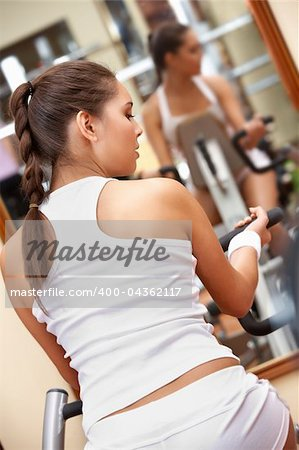 Photo of brunette doing exercises on the simulator Stock Photo - Budget Royalty-Free, Image code: 400-04362117