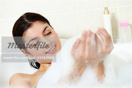 Image of serene woman having pleasant bath with foam Stock Photo - Budget Royalty-Free, Image code: 400-04363969