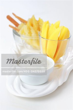 Healthy snack - Pineapple skewer with mango stripes and curd cheese or yogurt Stock Photo - Budget Royalty-Free, Image code: 400-04370550