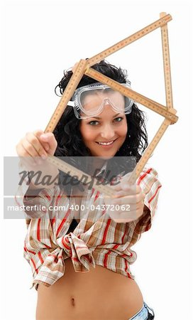 Young repair woman with a folding rule in her hand in form of house Stock Photo - Budget Royalty-Free, Image code: 400-04372062