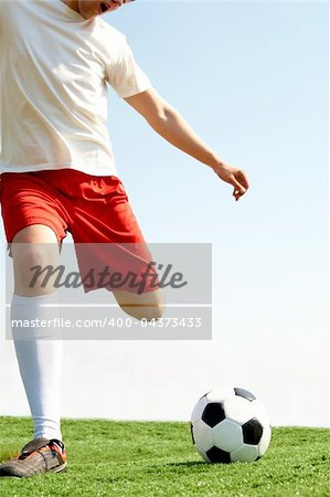 Portrait of a soccer player with ball on football field Stock Photo - Budget Royalty-Free, Image code: 400-04373433