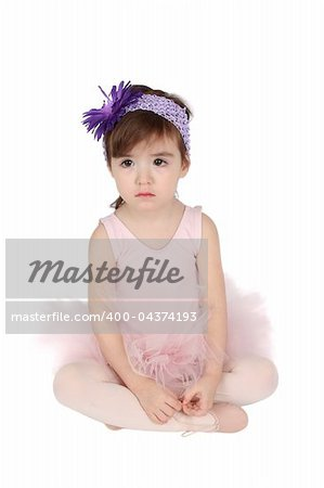 Serious brunette toddler wearing a pink tutu Stock Photo - Budget Royalty-Free, Image code: 400-04374193