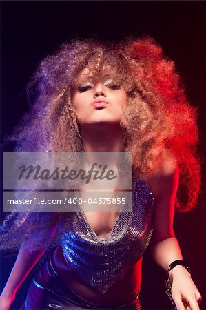 Beautiful blonde woman with handcuffs and  huge afro haircut Stock Photo - Budget Royalty-Free, Image code: 400-04375855