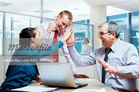 Image of glad businesspeople congratulating each other on corporate victory Stock Photo - Budget Royalty-Free, Image code: 400-04376517