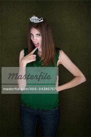 Cute homecoming queen with hand on hip and gagging gesture Stock Photo - Budget Royalty-Free, Image code: 400-04380757
