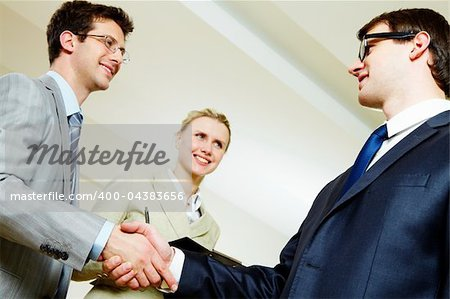 Portrait of business people shaking hands making an agreement