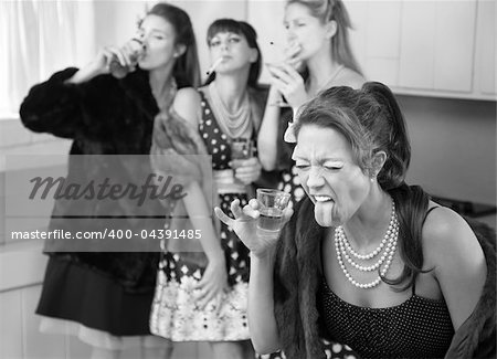 Woman reacts to strong alcohol while friends smoke and drink in the kitchen Stock Photo - Budget Royalty-Free, Image code: 400-04391485