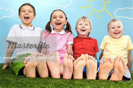 Group of happy children lying on a green grass Stock Photo - Budget Royalty-Free, Image code: 400-04391857