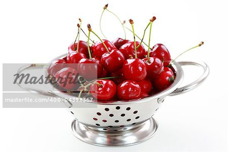 Fresh cherries in the bowl on white background Stock Photo - Budget Royalty-Free, Image code: 400-04398367