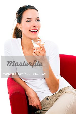 Young woman drinking a cocktail on white background studio