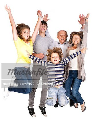 Jumping family having fun, enjoying indoors. Stock Photo - Budget Royalty-Free, Image code: 400-04398998