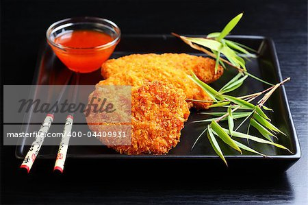 Fried chili chicken breast with hot dip Stock Photo - Budget Royalty-Free, Image code: 400-04409931