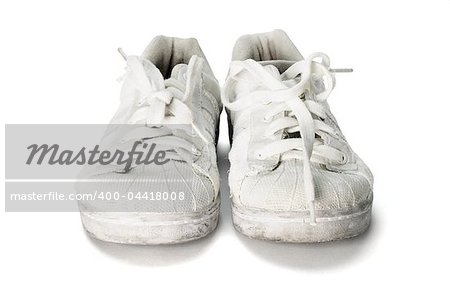 old worn out school canvas shoes on white background Stock Photo - Budget Royalty-Free, Image code: 400-04418008