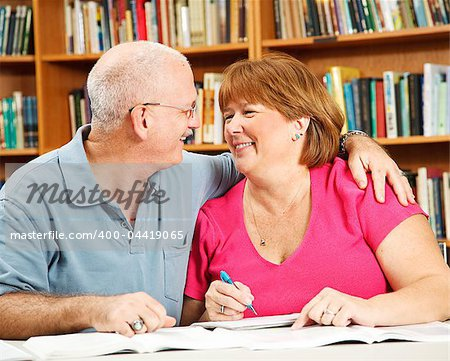 Mature couple has fun studying together at the library. Stock Photo - Budget Royalty-Free, Image code: 400-04419065