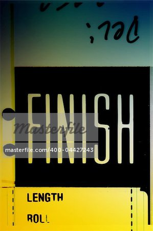 Piece of 35 mm motion film with the word 'finish' on it Stock Photo - Budget Royalty-Free, Image code: 400-04427243