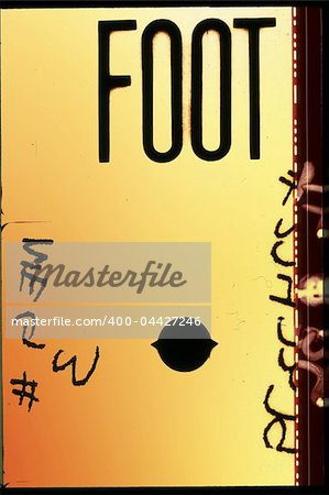 Piece of 35 mm motion film with the word 'foot' on it Stock Photo - Budget Royalty-Free, Image code: 400-04427246