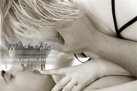 black and white image of sensual couple foreplay Stock Photo - Budget Royalty-Free, Image code: 400-04436824