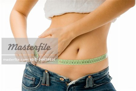 close up of a girl measuring her self with a green meter Stock Photo - Budget Royalty-Free, Image code: 400-04438816