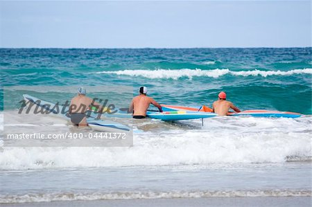 Iron men line up along the beach ready to start a race on their surf skis. Stock Photo - Budget Royalty-Free, Image code: 400-04441372