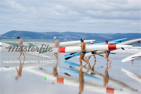 Iron men racers carry their boats to the water in preparation for a competition. Stock Photo - Budget Royalty-Free, Image code: 400-04441373