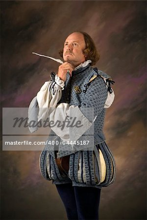 William Shakespeare in period clothing holding feather pen with thoughtful expression. Stock Photo - Budget Royalty-Free, Image code: 400-04445187