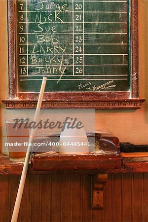 Chalkboard queue for people waiting to play billiards in nightclub with chalk and pool stick. Stock Photo - Budget Royalty-Free, Image code: 400-04445441