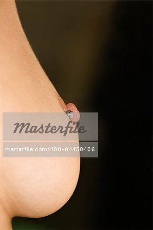Close up of Caucasian female young adult breast with pierced nipple. Stock Photo - Budget Royalty-Free, Image code: 400-04450406