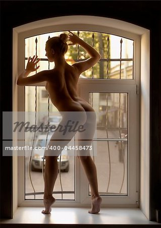 Nice woman in the window Stock Photo - Budget Royalty-Free, Image code: 400-04458473