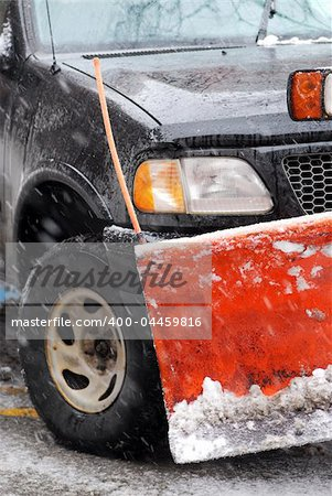Snow plow truck on a road during a snowstorm Stock Photo - Budget Royalty-Free, Image code: 400-04459816