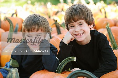 Boys Resting on a Pumpkin in the Pumpking Patch Stock Photo - Budget Royalty-Free, Image code: 400-04465793