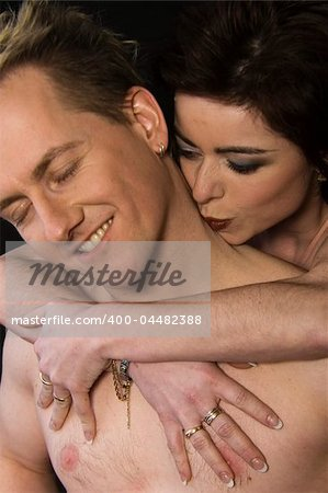 Married lovers portraits taken in the photo studio where she kisses his neck Stock Photo - Budget Royalty-Free, Image code: 400-04482388