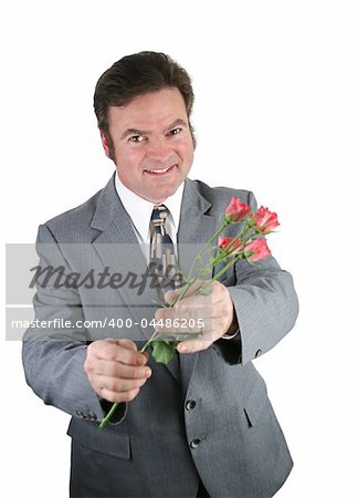 A husband apologizing to his wife by offering her pink roses. Stock Photo - Budget Royalty-Free, Image code: 400-04486205