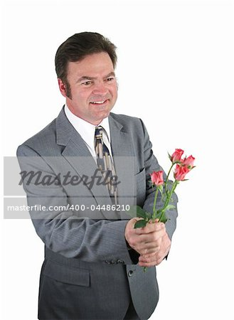 A handsome man in a suit bringing roses for his date. Stock Photo - Budget Royalty-Free, Image code: 400-04486210