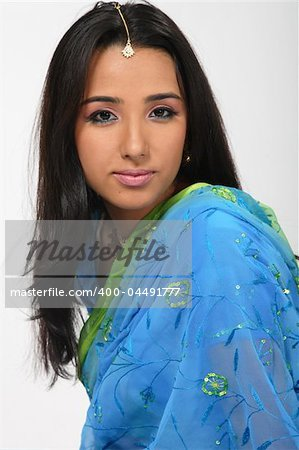 Indian girl in blue sari Stock Photo - Budget Royalty-Free, Image code: 400-04491777