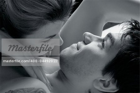 monochrome humorous portrait of sexy man in bed Stock Photo - Budget Royalty-Free, Image code: 400-04492011
