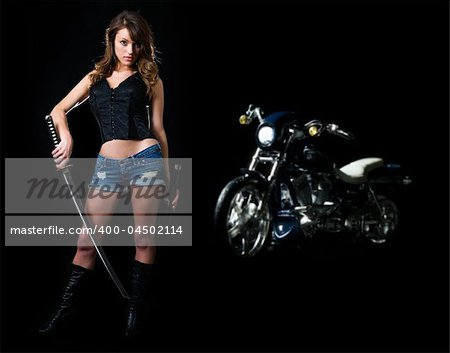 Attractive sexy woman in shorts holding a samurai sword standing beside a motorcycle on black Stock Photo - Budget Royalty-Free, Image code: 400-04502114