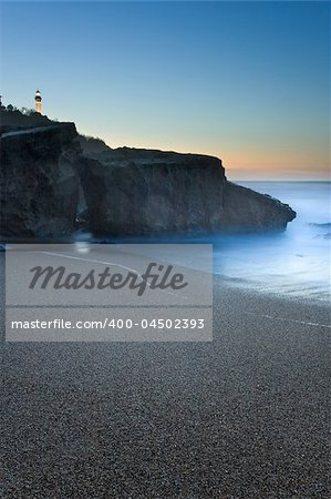 Beach of Anglet getting dark with the beacon of Biarritz to the bottom Stock Photo - Budget Royalty-Free, Image code: 400-04502393