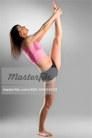 pretty gymnast stretching her legs Stock Photo - Budget Royalty-Free, Image code: 400-04506032